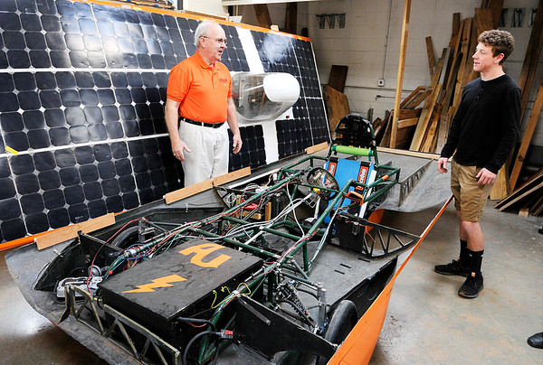 Don Knight   The Herald Bulletin<br /> From left, Larry George and Tom Sheahan talk about Anderson University's solar car. The university is looking for help funding their solar car project so students can travel and compete against others schools.