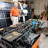 Don Knight | The Herald Bulletin<br /> From left, Larry George and Tom Sheahan talk about Anderson University's solar car. The university is looking for help funding their solar car project so students can travel and compete against others schools.