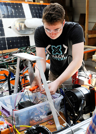 Don Knight | The Herald Bulletin<br /> Anderson University's Caleb Conrad troubleshoots a remote control electric go kart on Thursday. Students have plans to make the go kart self-driving.