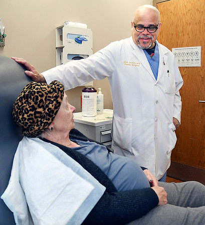 John P. Cleary | The Herald Bulletin <br /> Community Hospital Center for Advanced Wound Healing patient Mary Jo Featherston meets with her physician, Dr. Dion Chavis for a head wound due to cancer surgery.