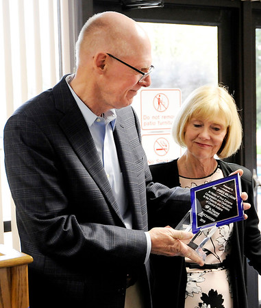 Don Knight | The Herald Bulletin<br /> His wife Jill by his side Dr. James Milligan is recognized for his 40 years of service during his retirement open house at St. Vincent Anderson on Friday.