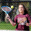 Don Knight | The Herald Bulletin<br /> Alexandria's Kelsey Rhoades returns a volley to Frankton's Chainey Lowe in the No. 2 singles match on Friday.