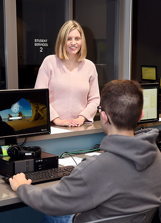 John P. Cleary | The Herald Bulletin <br /> Dr. Christina Collins, Ivy Tech Vice Chancellor of Enrollment Services and Student Success, talks with Nicholas Polus of Daleville. Polus is transferring to Ivy Tech from Purdue, West Lafayette, to study nursing.