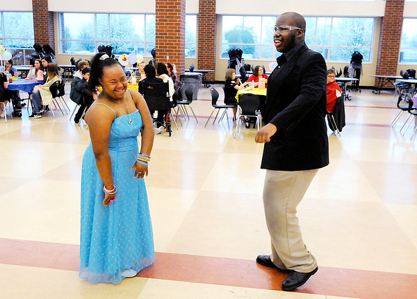 Don Knight   The Herald Bulletin<br /> From left, Calista Watson and Samual Hardin dance during Anderson High School's 10th annual special needs prom in the cafeteria on Thursday.