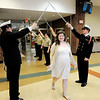 Don Knight | The Herald Bulletin<br /> Taylor Craig walks through a tunnel of swords as Anderson High School held their 10th annual special needs prom in the cafeteria on Thursday.