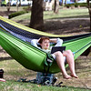 John P. Cleary | The Herald Bulletin <br /> With it starting to feel like spring, with above-normal temperatures and sunshine, Emily Frost, an Anderson University sophomore from McCordsville, faces west in her hammock to catch all the sun she can as she studies with her laptop Monday afternoon on campus.