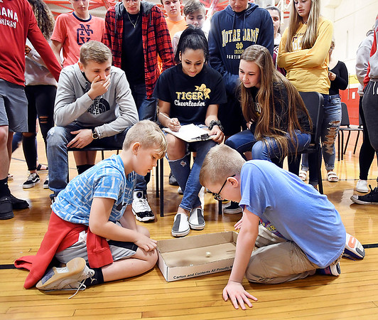 John P. Cleary   The Herald Bulletin <br /> Alexandria Intermediate School third-grader Cole Johns and fourth-grader Kaiden Adams compete in a semi-final match as everyone gathers around to watch. Kaiden won the match and finished second overall and Cole finished third for the tournament.