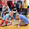 John P. Cleary | The Herald Bulletin <br /> Alexandria Intermediate School third-grader Cole Johns and fourth-grader Kaiden Adams compete in a semi-final match as everyone gathers around to watch. Kaiden won the match and finished second overall and Cole finished third for the tournament.