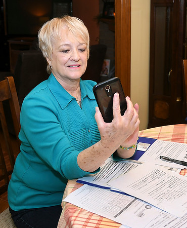 John P. Cleary | The Herald Bulletin  <br /> Senior Link volunteer Linda Embree makes a call to check up on one of the seniors participating in the program.