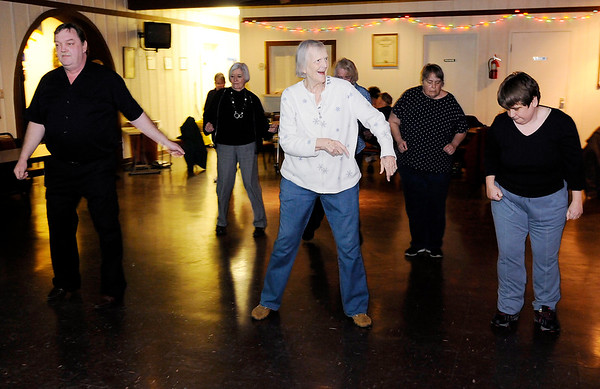 Don Knight | The Herald Bulletin<br /> Seniors line dance as D.J. Buddy Patterson plays the Cupid Shuffle  at the Legion on Saturday. Legion 2nd Vice Commander Darrell Baylor said the dances give seniors an opportunity to get out and to socialize and exercise.