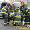Don Knight | The Herald Bulletin<br /> Stoney Creek fire fighters move Jesse McCurdy after extricating him from a car in a mock accident at Lapel High School on Friday.