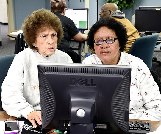 John P. Cleary | The Herald Bulletin  <br /> Patty Sample, a volunteer for the free tax help program at the Anderson Impact Center, assists client Anna Hampton as she goes through and fills out her tax forms this past week.