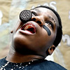 John P. Cleary | The Herald Bulletin <br /> Detorio Fleming,14, uses all his facial muscles to try and get this cookie from his forehead to his mouth without using his hands during the annual ISTEP+ Olympics at ACS's COMPASS school Friday. Fleming is a eighth-grader at the school.