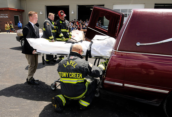 Don Knight   The Herald Bulletin<br /> Anna Willis, playing the part of a fatality in a mock accident, is loaded into a hearse at Lapel High School on Friday. Students observed first responders work the mock accident as a reminder the consequences of bad decisions.