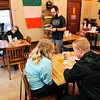 Don Knight | The Herald Bulletin<br /> Nathaniel Iman asks trivia questions about Star Wars as from left Judy Odom and Travis and Amber Scott write down their answers at 5's Tap Room on Tuesday.