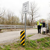 Don Knight | The Herald Bulletin<br /> County Engineer Joe Copeland talks to local resident Robert Moreland at the bridge over Killbuck Creek on County Road 425 East on Wednesday. The bridge is one of six identified as needing to be replaced.