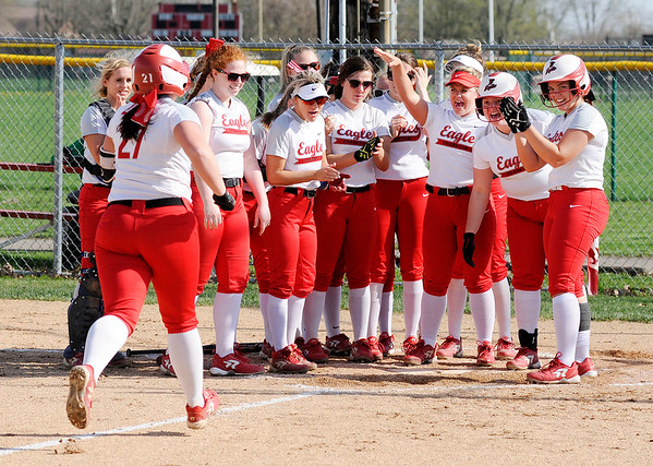 Don Knight | The Herald Bulletin Frankton's Aubrey Adiar arrives at home plate where her teammates are waiting after she hit a home run against Anderson on Wednesday.