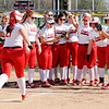 Don Knight | The Herald Bulletin<br /> Frankton's Aubrey Adiar arrives at home plate where her teammates are waiting after she hit a home run against Anderson on Wednesday.
