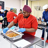 John P. Cleary | The Herald Bulletin <br /> D26 Career Center culinary arts students prepare food Monday morning for the Harlem on My Plate event later in the day. The students were preparing candied sweet potatoes, cornbread, peach cobbler, collard greens and fresh squeezed lemonade.