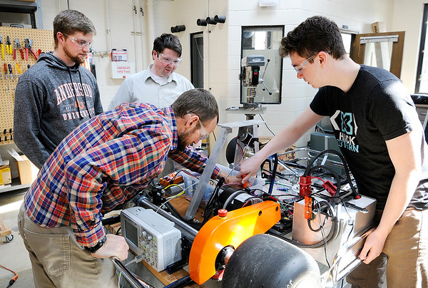 Don Knight   The Herald Bulletin<br /> From left, Dr. Kyle Tarplee, Davis Peterson, Dr. Willis Troy and Caleb Conrad troubleshoot a remote control electric go kart on Thursday.