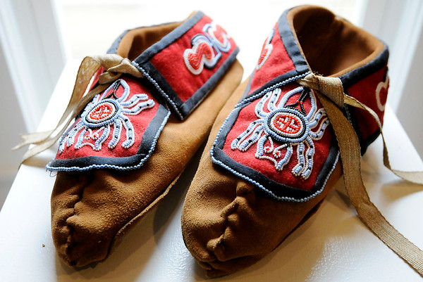 Don Knight   The Herald Bulletin<br /> Moccasins with beadwork of water spiders are part of an exhibit of Southeastern Woodlands Beadwork by artist Carolyn Pallett on at Park Place Arts.