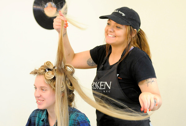 Don Knight   The Herald Bulletin<br /> Taylor Vanevenhoven styles Montannah Prewett's hair for APA's prom at Detour Salon & Style on Saturday.