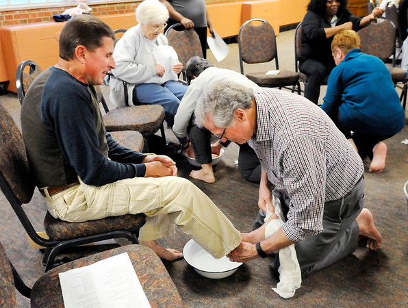 Don Knight | The Herald Bulletin Bob Edwards washes Mark Lashbrook's feet during Park Place Church of God's Maundy Thursday service. The foot washing and the preceding communion meal are among the ordinances observed by the Church of God.
