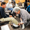 Don Knight | The Herald Bulletin<br /> Bob Edwards washes Mark Lashbrook's feet during Park Place Church of God's Maundy Thursday service. The foot washing and the preceding communion meal are among the ordinances observed by the Church of God.