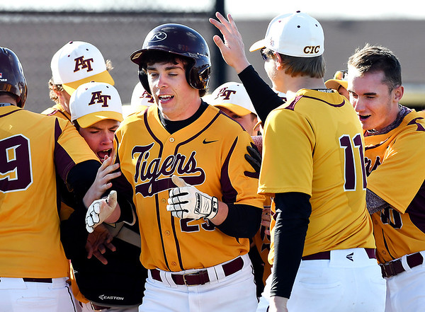 John P. Cleary | The Herald Bulletin <br /> Alexandria's Rylan Metz gets congratulated by his teammates after hitting a 3-run homer in the third inning for Alexandria to take the lead over Daleville.