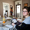 Caitlin Evans, who runs an after school program for South Madison Schools, works from her 'new office', her dining room table in her Markleville home.