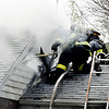 Firefighters from multiple agencies battled a residential structure fire Tuesday morning in the 200 block of County Road 650 North. Here firefighters work from the roof to get to the attic area to knock down the fire and vent the heat from the structure.
