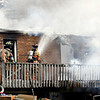 Firefighters from multiple agencies battled a residential structure fire Tuesday morning in the 200 block of County Road 650 North.