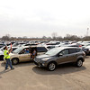 Charles Mudd with EMA parks cars waiting in line for a Second Harvest Food Bank tailgate distribution on Saturday.