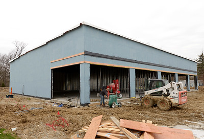Construction continues on a shopping center that will house three businesses on Scatterfield across from Office Depot.
