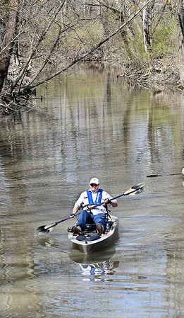 Rick Cook, of Alexandria, keeps his social distance as he enjoys the warm sunshine doing some boating on Shadyside Lake in his fishing kayak Monday afternoon.