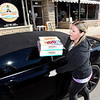 Alexis Williams, manager of Quack Daddy Donuts in Pendleton, gets into her car to make a delivery of fresh donuts to a customer Thursday morning.