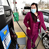 Jessica Woschitz pumps gas at the getGo store in Edgewood Thursday where there are large stickers on the pumps showing the percent of ethanol that is blended into the gasoline.