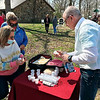 Jay Harvey, pastor at Anderson's City Church, offers Communion on Sunday to Angie Kinser during the Easter service at Shadyside Park.
