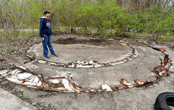 Tess Etchison checks out the area where an old storage tank has been removed from the ALAC industrial laundry property, leaving sharp and jagged pieces of the metal around the base where someone could get hurt on since the 15-acre property is unsecured.