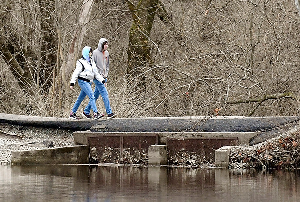 """These folks were """"stepping in time"""" as they set a good pace while walking around the south end of Shadyside Lake on a cold & blustery day."""