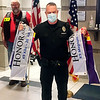 APD Officer Matt Jarrett holds the honor and sacrifice flags for fallen K9 officers Magnum and Kilo during Saturday's ceremony.