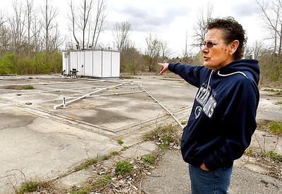 Anderson resident Tess Etchison looks over the area that IDEM installed an air sparge/dual phase extraction system on the former ALAC property site to manage any contamination.