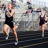 Madison-Grant's Emma Ewer wins the 100 dash as the Argylls hosted Daleville and Bluffton on Monday.