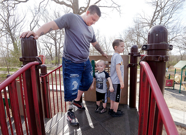 Walking on his new prosthetic, Kalob Harrison spends time with his sons Belame Smith, 3, and Laidon Smith, 5, at Shadyside Park in Anderson. After using crutches for seven years, Harrison is walking again with the help of two people he just recently met.