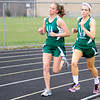 Pendleton Heights' Emma Manchess and Maddi Hinton lead the girls' 1600 meter race during the Madison County Track Tournament at Madison-Grant on Friday.