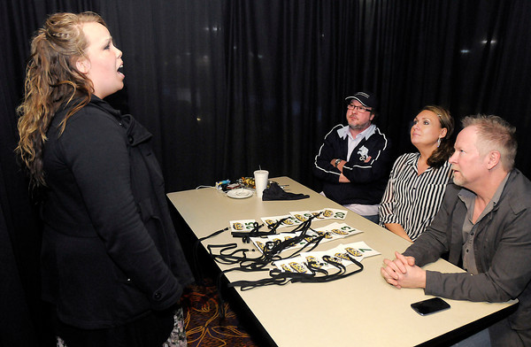 Melissa Nolan, a Ball State student from Bluffton, sings for judges, from left, Chad Evans, Michelle Bell-Cook and Mark Pay, during Hoosier Idol auditions at Hoosier Park last Thursday. To purchase this photo or other photos produced by The Herald Bulletin staff, visit heraldbulletin.smugmug.com.