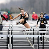 From left, Madison-Grant's Shannon Wallace, Lapels Adrienne Jones and Paige Hendershot and Anderson's Shantex Goolsby compete in the girl's 100 meter hurdles during the Madison County Track Tournament at Madison-Grant on Friday. Wallace finished first followed by Jones.