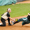 Madison Grant's Kayla Stanley tags Pendleton Heights' Elizabeth Sigler out at third  in the second round of the County Softball Tournament at Pendleton on Wednesday.