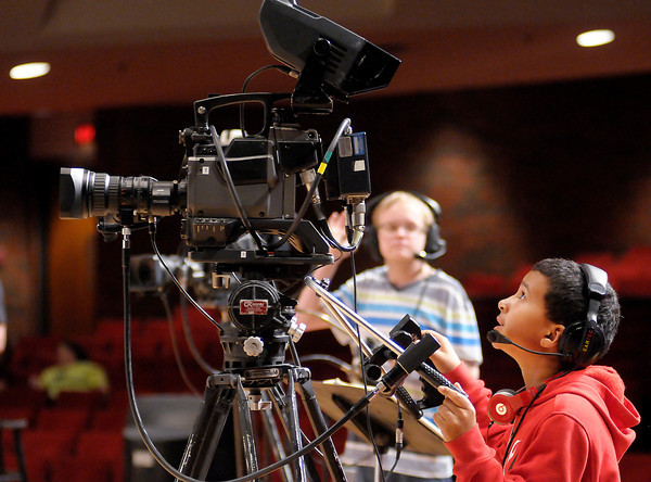 Nalen Wade, 12, gets a chance to operate a camera during the Bids for Kids Auction at Reardon Auditorium on Friday. To purchase this photo or other photos produced by The Herald Bulletin staff, visit heraldbulletin.smugmug.com.