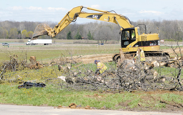 A crew from 3D Company Inc. clears trees from the intersection of Indiana 38 and County Road 300 West on Thursday as work on a traffic circle at the intersection begins. To purchase this photo or other photos produced by The Herald Bulletin staff, visit heraldbulletin.smugmug.com.